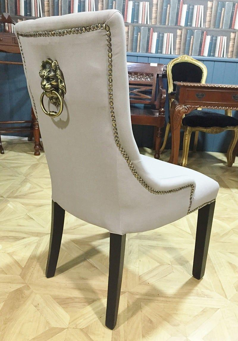 Cream brass studded dining chair with lion knocker for Studded dining room chairs