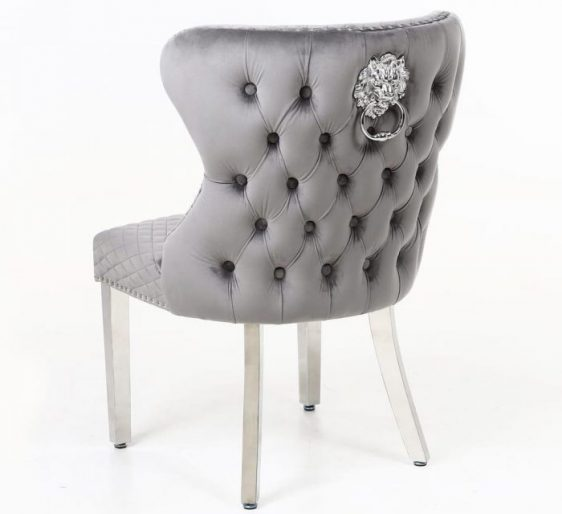 Grey Velvet & Chrome Deep Buttoned Dining Chair - Chrome Lion knocker This Grey Dining Chair is a great new design to add to the Dining Chair Range Range - rich velvet with a deep button design and chrome pull ring. See the matching bar stool pictures attached. Available in Cream - Black - Pink & Grey velvet. View our full Bar Stool CollectionCLICK HERE View our full Dining Chair CollectionCLICK HERE